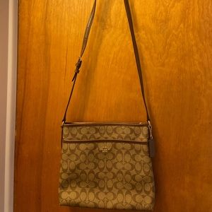 Brown Coach crossbody purse with adjustable strap